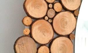 Отделка стены спилами дерева
